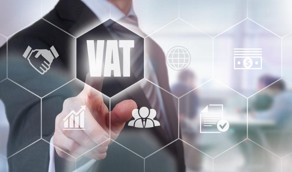Businessman pressing a VAT concept button.